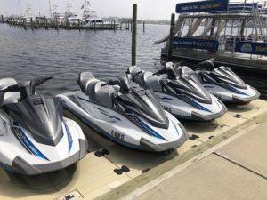 4 Jet skis docked ready to rent on the destin harbor